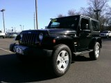 2011 Black Jeep Wrangler Sahara 4x4 #100957022