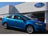 2015 Blue Candy Metallic Ford Focus SE Sedan #101034170