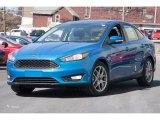 2015 Blue Candy Metallic Ford Focus SE Sedan #102308278