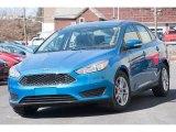 2015 Blue Candy Metallic Ford Focus SE Sedan #102308277