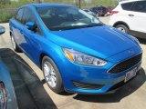 2015 Blue Candy Metallic Ford Focus SE Sedan #102584569