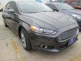 2015 Magnetic Metallic Ford Fusion SE #102884376