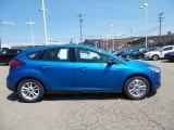 2015 Blue Candy Metallic Ford Focus SE Hatchback #103784178