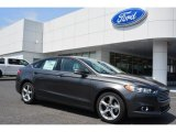 2015 Magnetic Metallic Ford Fusion SE #103869127