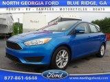 2015 Blue Candy Metallic Ford Focus SE Sedan #105250654