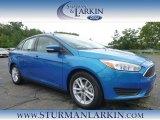 2015 Blue Candy Metallic Ford Focus SE Sedan #105489185