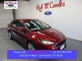 2015 Ruby Red Metallic Ford Focus SE Sedan #105638546