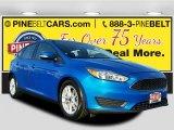 2015 Blue Candy Metallic Ford Focus SE Hatchback #117727200