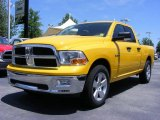 2009 Detonator Yellow Dodge Ram 1500 SLT Quad Cab #11892152