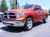 2009 Sunburst Orange Pearl Dodge Ram 1500 SLT Quad Cab #11892138