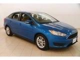 2015 Blue Candy Metallic Ford Focus SE Sedan #127437340