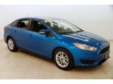 2015 Blue Candy Metallic Ford Focus SE Sedan #127521082
