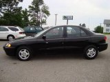 2003 Black Chevrolet Cavalier Sedan #12861149