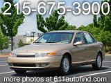 2001 Medium Gold Saturn L Series L300 Sedan #12861992