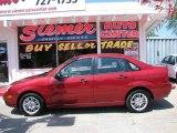 2005 Sangria Red Metallic Ford Focus ZX4 SE Sedan #13238640