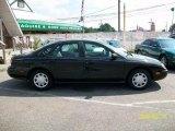 1997 Ford Taurus Ebony Black Satin Metallic