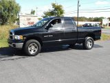 2004 Black Dodge Ram 1500 SLT Quad Cab 4x4 #19365794