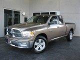 2010 Austin Tan Pearl Dodge Ram 1500 Big Horn Quad Cab #23905060