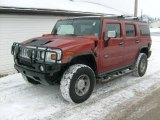 2003 Sunset Orange Metallic Hummer H2 SUV #24436598