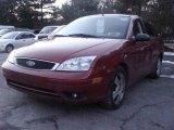 2005 Sangria Red Metallic Ford Focus ZX4 SES Sedan #24436666