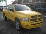 2005 Solar Yellow Dodge Ram 1500 SLT Quad Cab 4x4 #25580975