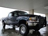 Dark Blue Pearl Metallic Ford F350 Super Duty in 1999