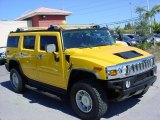 2003 Yellow Hummer H2 SUV #25792721