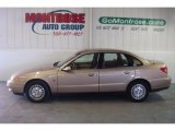 2001 Medium Gold Saturn L Series L200 Sedan #26778484