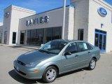 2004 Light Tundra Metallic Ford Focus SE Sedan #27324932