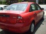 2005 Sangria Red Metallic Ford Focus ZX4 SE Sedan #29342326