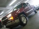 2005 Sport Red Metallic Chevrolet Silverado 1500 LS Extended Cab 4x4 #33328670