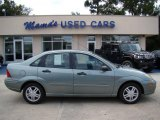 2004 Light Tundra Metallic Ford Focus SE Sedan #35788998