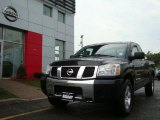 2007 Galaxy Black Nissan Titan SE King Cab 4x4 #36622602