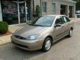 2004 Arizona Beige Metallic Ford Focus LX Sedan #37125535