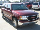 Garnet Red Metallic GMC Yukon in 2002