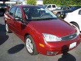 2005 Sangria Red Metallic Ford Focus ZX4 SES Sedan #3899268