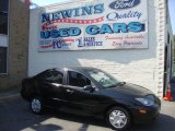 2004 Pitch Black Ford Focus SE Sedan #39741101