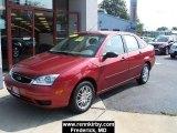 2005 Sangria Red Metallic Ford Focus ZX4 SE Sedan #4777829