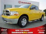 2009 Detonator Yellow Dodge Ram 1500 SLT Quad Cab #48193962