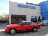 2005 Torch Red Ford Mustang V6 Deluxe Coupe #48460536