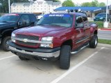 2004 Sport Red Metallic Chevrolet Silverado 1500 LS Extended Cab 4x4 #48866861