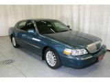 Medium Steel Blue Metallic Lincoln Town Car in 2003