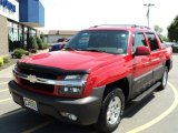 Victory Red Chevrolet Avalanche in 2003