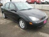 2003 Pitch Black Ford Focus SE Sedan #50690349