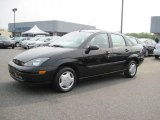2004 Pitch Black Ford Focus LX Sedan #51289710