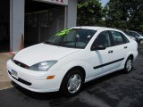 2003 Cloud 9 White Ford Focus LX Sedan #52118259
