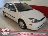 2004 Cloud 9 White Ford Focus LX Sedan #53004622