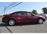 Dark Garnet Red Pearl Chrysler Sebring in 2002