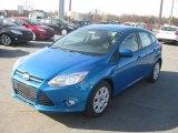 2012 Blue Candy Metallic Ford Focus SE 5-Door #56705052