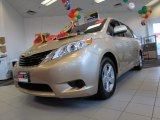2011 Sandy Beach Metallic Toyota Sienna LE #57610712